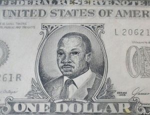 "Close-up: Dr. Martin Luther King Jr. on a ""Legal Tender"" dollar bill by River City Art Association artist Don Turner is featured during Black History Month in the Vigo County Public Library."