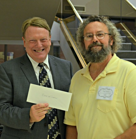 Terry Tevlin presents Best of Show winnings to RCAA vice president Todd Stokes