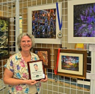 First and Second Place in Photography/Digital Art: Angry Peacock and The Woods Enchanted by Sheila K. Ter Meer; also recipient of the Marty Martinez Contributory Award