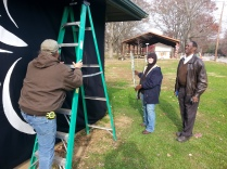 RCAA members work on Christmas in the Park shelter in Deming Park
